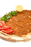 Turkish pizza. On a wooden board Royalty Free Stock Images