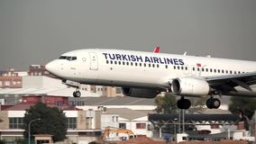 Turkish plane landing in super slow motion. VALENCIA, SPAIN - OCTOBER 26: Turkish airlines plane lands with home buildings in the backgrond to Valencia airport stock footage