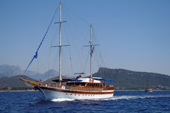Turkish pleasure yacht. And coast Royalty Free Stock Photos