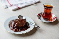 Turkish Pudding Muhallebi with Chocolate Sauce and Traditional Tea. Dessert Concept royalty free stock images