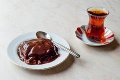 Turkish Pudding Muhallebi with Chocolate Sauce and Traditional Tea. Dessert Concept stock photos