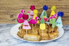 Turkish Ramadan Dessert Baklava with Party Sticks. Traditional Turkish Arabic Dessert - Baklava with Nuts royalty free stock photos
