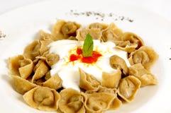 Turkish ravioli. A ravioli-like dish served with yogurt Royalty Free Stock Photo