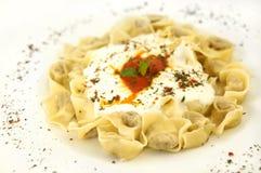 Turkish ravioli. A ravioli-like dish served with yogurt Stock Images