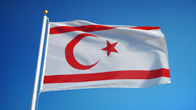 Turkish Republic of Northern Cyprus flag in slow motion seamlessly looped with a. Turkish Republic of Northern Cyprus flag in slow motion against blue sky stock video