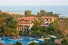 Turkish resort. Pool, sea and bungalows in Turkey Stock Image