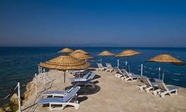Turkish resort. Sunshades in Turkish resort in the Aegean sea Royalty Free Stock Images