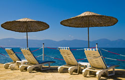 Turkish resort. Sunshades in Turkish resort in the Aegean sea Royalty Free Stock Image