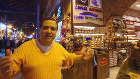 Turkish salesman at Spice Bazaar Misir Carsisi stock video