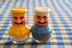 Turkish salt and pepper shakers. Right out of grandma's kitchen! Turkish salt and pepper shakers in yellow and blue on a tablecloth background Stock Image