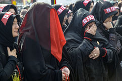 Turkish Shia women mourn during an Ashura procession in Istanbul. Istanbul, Turkey - November 3, 2014: Universal Ashura Mourning Ceremony. Day of Ashura. Turkish Stock Photos