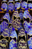 Turkish shoes on sale. Ordered and coloured shoes, slippers on sale in Istanbul Royalty Free Stock Photos