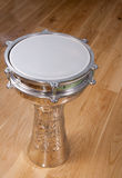Turkish silver drum on a wooden floor Stock Photos