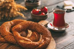 Turkish Simit Bagel on Rustic Table. Turkish Simit Bagel on Rustic Wooden Table royalty free stock photography