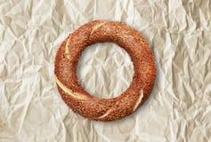 Turkish crisp simit. `Turkish simit` on a wrinkled paper Stock Photos