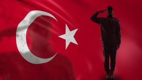 Turkish soldier silhouette saluting against national flag, army conscription. Stock footage stock footage