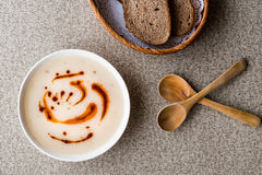 Turkish Soup Dugun Corbasi with fried butter sauce and bran bread. Royalty Free Stock Photography