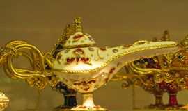 Turkish souvenir tea pot magic lamp. Luxury expencive tea pot set of silver with ornaments sold on the Grand Bazaar in Istanbul, Turkey Royalty Free Stock Photo