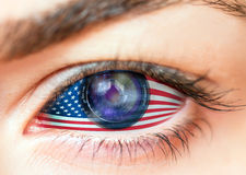 Flags of the USA in beautiful female lens eye (camera-like) Stock Image