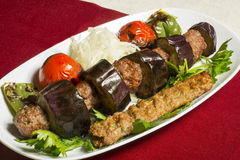 Turkish spicy meatballs with grilled vegetables Royalty Free Stock Photography