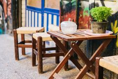 Turkish street cafe in Istanbul. Wooden table and chairs stand directly on the street. A distinctive and authentic place. To visit by locals. Morning time. It`s Stock Photos
