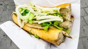 Turkish street food fish bread with onions and greens / Balik Ekmek stock image