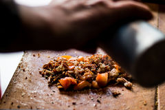 Turkish Street food kokorec.Man is pouring spice on fried sheep bowel Stock Image