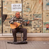 Turkish Street Musician. ISTANBUL, TURKEY – APRIL 28: Street musician performing on an oud prior to ANZAC day on April 28, 2012 in Ankara, Turkey.  Each year Royalty Free Stock Photo