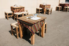 Turkish street street coffees in Istanbul. Wooden tables and chairs stand directly on the street. A distinctive and. Authentic place to visit by locals. Morning Royalty Free Stock Image
