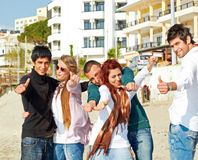 Turkish students showing thumbs up on the beach . Stock Photos