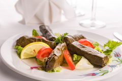 Turkish Style Dolmas Arranged with Tomatoes Lemon and Lettuce Stock Photo