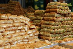 Pile of baklawa at the food market in Israel. Baklava in the market , Sweet pastry in the Arab kitchen Stock Image