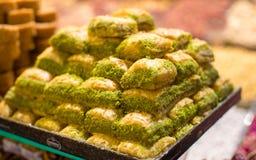 Turkish sweet baklava made of thin pastry, nuts. Turkish baklava made of thin pastry, nuts and honey Royalty Free Stock Photos