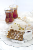 Turkish sweet confectionery. Tahini halva and turkish delight served with chai Stock Photos