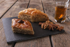 Turkish sweets baklava with tea nuts and cinnamon Royalty Free Stock Photo