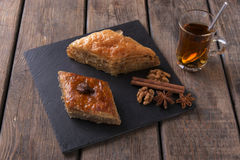 Turkish sweets baklava with tea nuts and cinnamon Royalty Free Stock Photos