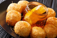 Turkish sweets balls kadaif with fresh honey close-up. horizonta Stock Photo