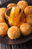 Turkish sweets balls kadaif with fresh honey close-up. Vertical Royalty Free Stock Image