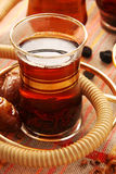 Turkish tea. Glasses with tea and dry fruit Stock Photos