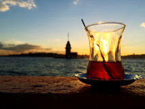 Turkish tea against maiden`s tower in Istanbul, Turkey Stock Images