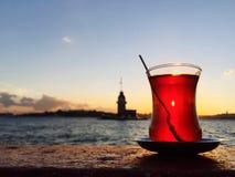 Turkish tea against maiden& x27;s tower in Istanbul, Turkey Stock Image
