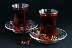 Turkish tea on black. Turkish Traditional Tea in glasses on black Royalty Free Stock Photography