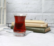Turkish tea with books. Drinking Turkish tea and read books Royalty Free Stock Images