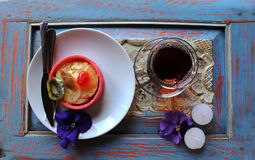 Turkish tea and cake  with candles,  and flowers. On the blue wooden table Stock Photo