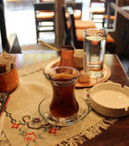 Turkish tea and coffee on the table. With traditional tablecloth Stock Image