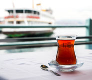 Turkish tea cup. On the background of port in Istanbul Stock Photos