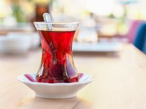 Turkish tea cup and classic tea cup mat on wooden table royalty free stock photos
