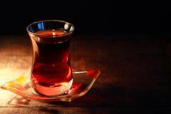 Turkish Tea. Cup of Turkish tea on saucer on dark background Stock Image