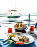 Turkish tea cup and sea bass Royalty Free Stock Image