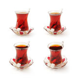 Traditional Turkish tea. Set of traditional glass cups of Turkish tea isolated on a white studio background Stock Photo
